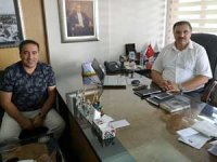 Antalya İl Kültür ve Turizm Müdürü İbrahim Acar, KEMİAD Başkanı Özgür Kurga'ya Idyros antik kenti için teşekkür etti
