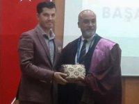 Turizmci Hüseyin Aslan 'a Akademisyenlerden başarı belgesi aldı